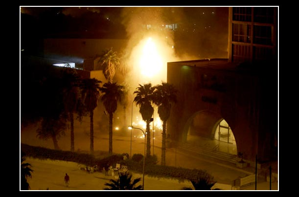 baghdad's sheraton hotel burning after attacked