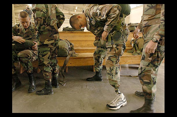 A soldier checks his prosthetic leg as he prepares to jump over Pope Air Force Base, North Carolina