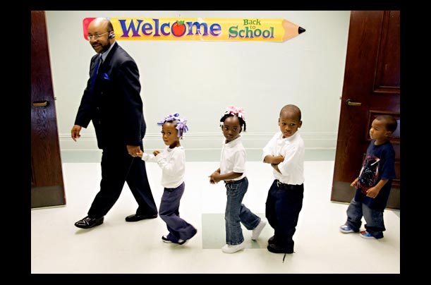 Superintendent leads students to the cafeteria at Benjamin Franklin Elementary School in New Orleans after Hurricane Katrina