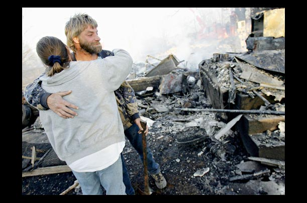Brian Huffman gets a hug from friend Pippa Metcalf after his home was destroyed in a fire in Mustang, Oklahoma