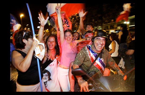 Supporters of Socialist candidate Michelle Bachelet celebrate her victory in the run-off presidential elections in Santiago, Chile