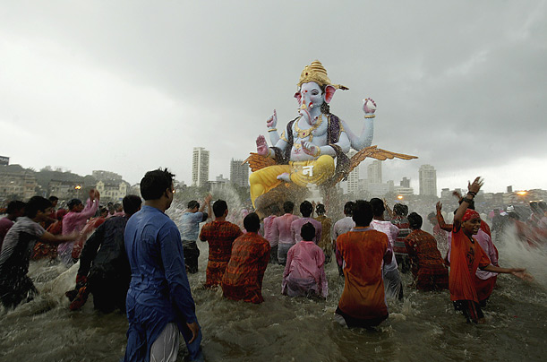 Worshippers splash the elephant-headed Hindu God Ganesh before its immersion in the sea, part of a ten-day festival honoring the deity in Mumbai, India.