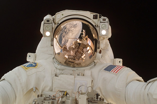 Astronaut Scott Parazynski makes a third space walk as construction continues on the International Space Station.