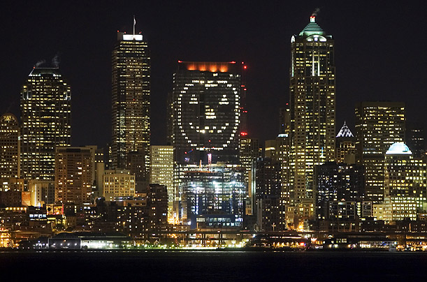 A pattern of lights forms a giant 275-foot jack-o-lantern on the side of WaMu Center in downtown Seattle.