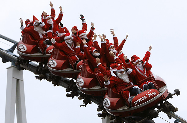 Santa Clauses ride a rollercoaster at the Europa Park leisure park in Rust, Germany.