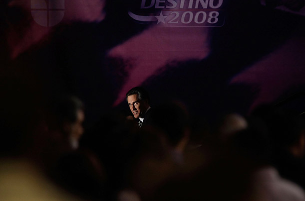 Republican presidential hopeful Mitt Romney exits at the end of the Univision Republican forum in Miami, Florida.