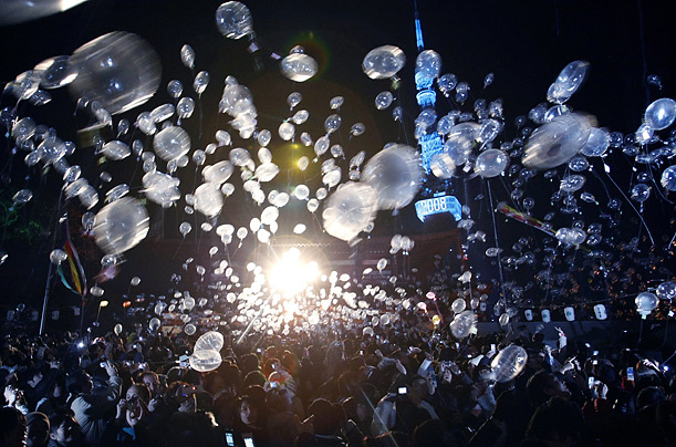 Transparent white balloons are released to mark the New Year at the Zojoji temple in Tokyo.