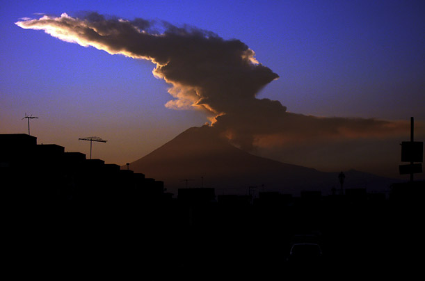 The Popocatepetl volcano, near Puebla, Mexico, sends out a plume of smoke and steam. The volcano has been intermittently erupting since December 1994.