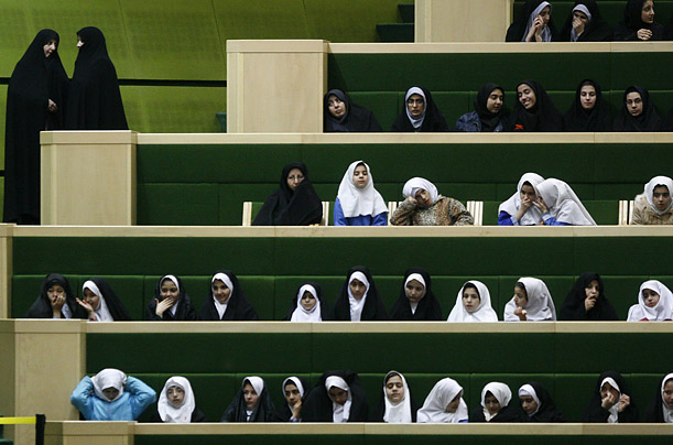 Iranian schoolgirls follow the debate of parliament for nominee of Minister of Education, Alireza Aliahmadi, unseen, in Tehran, Iran.