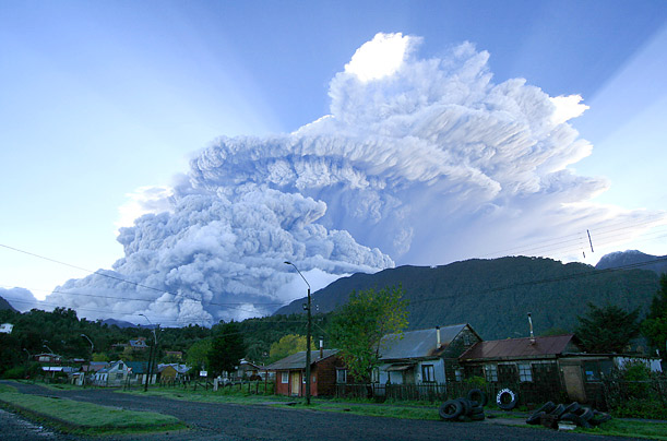 A cloud of smoke and ashes produced by an eruption of the Chaiten volcano rain over Chaiten, Chile. The eruption spewed ash 20 miles into the Andean sky, forcing authorities