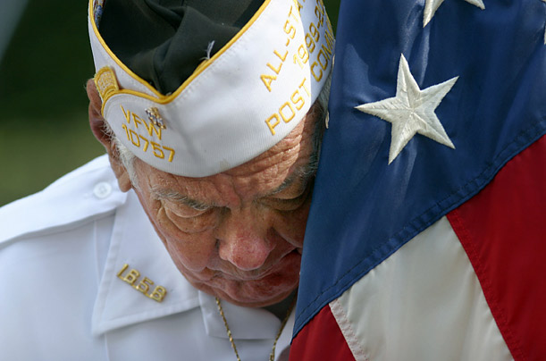 James Mulligan, of Tarpon Springs, Florida, listens to a pastor's at a Memorial Day Observance in Palm Harbour