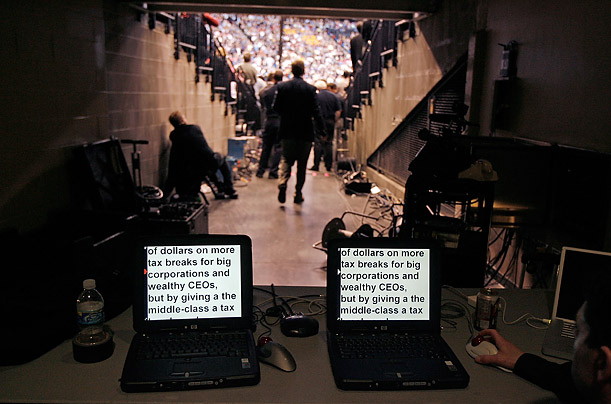 Computer screens controlling teleprompters display the speech being given by Democratic presidential hopeful Senator Barack Obama during a rally at the Xcel Energy Center in St. Paul, Minnesota.