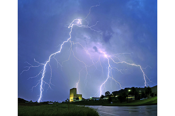 Lightning streaks through the skies over the Silvi Concrete factory in Downingtown, Pennsylvania.