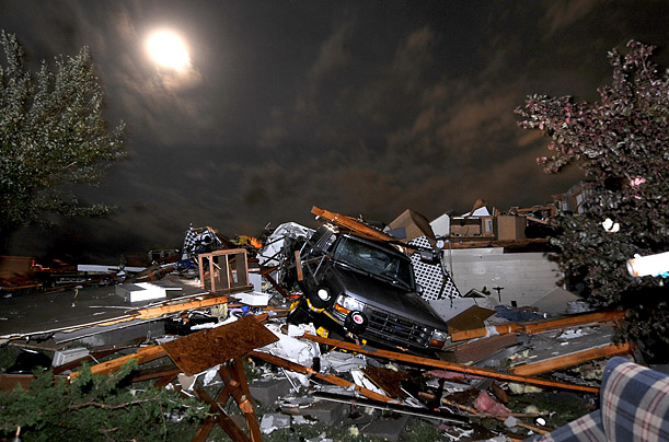 A pickup truck lies in the wreckage on Holmes Road southeast of Salina, Kansas, after a tornado passed through the area.
