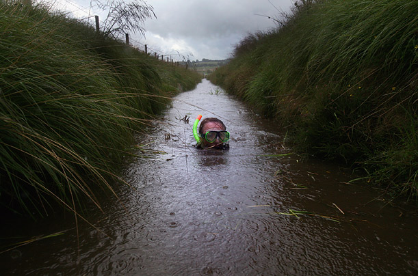 A competitor takes part in the third annual World Bog Snorkeling Triathlon in Llanwrtyd Wells, Wales.