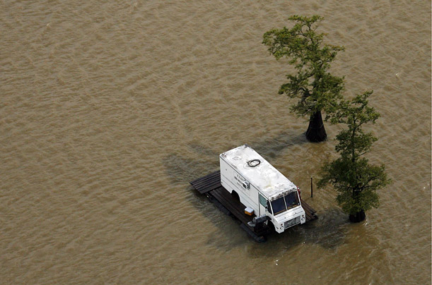A van sits atop a platform in the Atchafalaya Basin Floodway near Lafayette, La. a day after Hurricane Gustav hit the Gulf Coast
