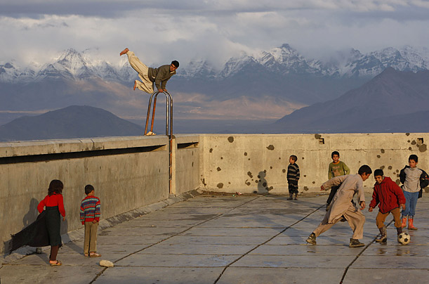 People play in an empty swimming pool in Kabul, Afghanistan.