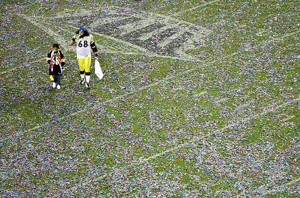 Pittsburgh Steelers guard Chris Kemoeatu walks off the field after the Steelers won the Super Bowl in Tampa, Florida.