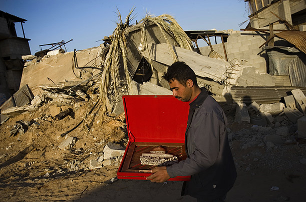 A Gaza resident carries a framed picture of the Dome of the Rock that he received at an event organized by Hamas in the town of Moghraka.