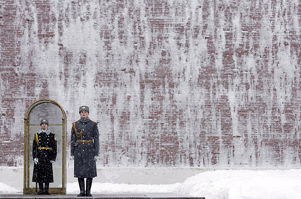 Soldiers stand at the Tomb of the Unknown Soldier beside the Kremlin wall in Moscow, Russia.
