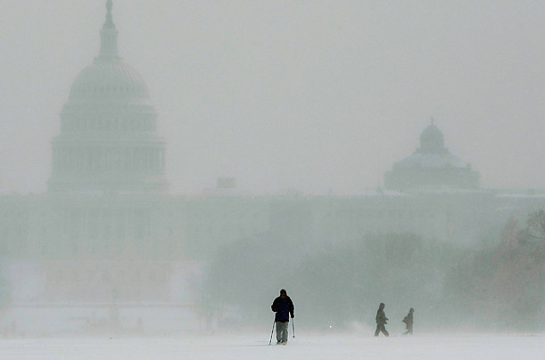 A man skis across the National Mall after a snowstorm hit Washington DC.