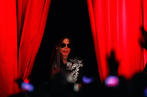 Michael Jackson stands before the crowd which has gathered to hear his announcement describing ten shows he plans to perform at London's O2 Arena this summer.