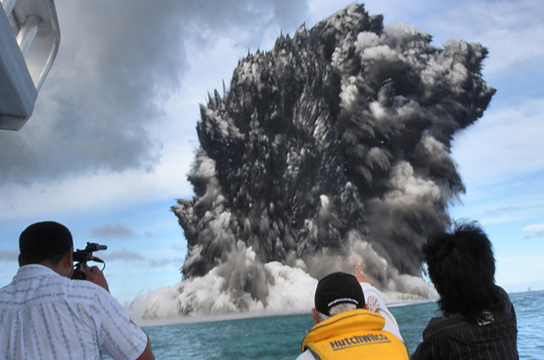 An undersea volcano erupts off the coast of Tonga, sending plumes of smoke and steam into the air.