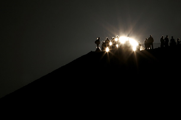 People watch the sun rise during the spring equinox at the Pyramid of the Sun in Teotihuacan, Mexico.