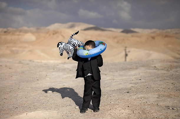 A Palestinian boy plays with an inflatable toy during celebrations marking the annual day of Nebi Musa.