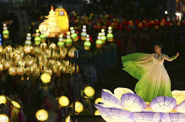 A Buddhist in Seoul, South Korea dances on a lotus lantern to celebrate the upcoming birth anniversary of Lord Buddha.