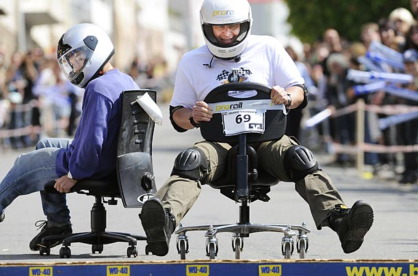 Participants in the German office chair race championships compete on a 200-metre course that includes obstacles.