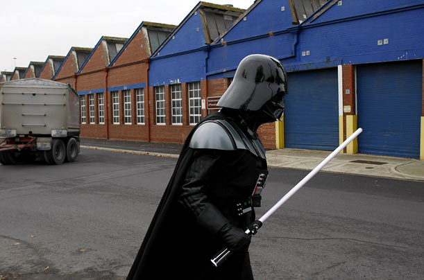 A man dressed as Darth Vader arrives for the launch of an exhibition in Melbourne that showcases an array of costumes
