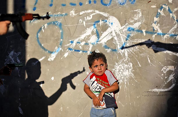 Palestinian boys play with toy guns in a refugee camp in Ramallah.