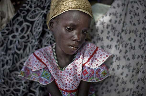 A Nuer girl waits to be admitted at a health clinic run by the medical charity Doctors Without Borders in Nasir, Sudan.