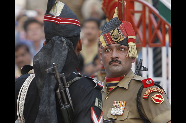 Border guards of India, right, and Pakistan, face one another at a daily closing ceremony at the Wagha border post near Lahore, Pakistan.