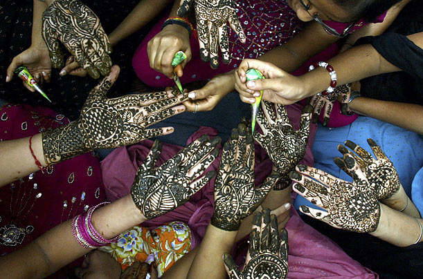 To welcome the advent of monsoon season, women in Amritsar, India, decorate their hands with henna paste.