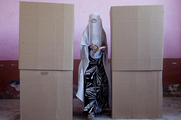 A woman casts her ballots in the Afghan presidential election at a polling station in Mazar-i-Sharif.