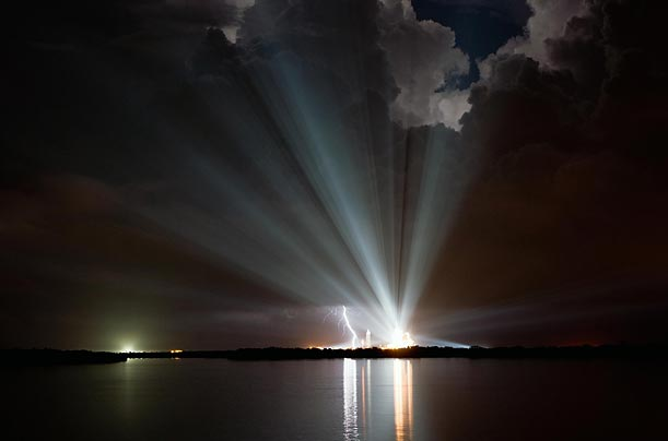 Xenon lights shine over Launch Pad 39A before NASA canceled the first launch attempt for Space Shuttle Discovery on mission STS-128 due to