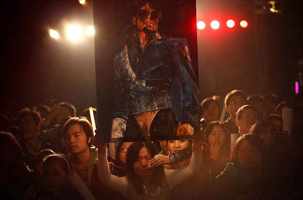 A fan of Michael Jackson cries before a screening of the Jackson documentary, This Is It in Beijing, China.