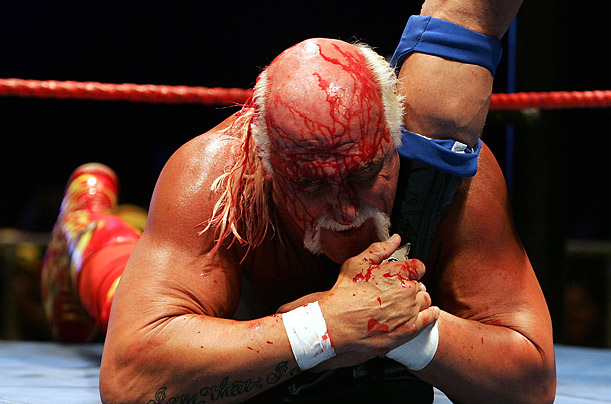 Hulk Hogan grabs the leg of Rick Flair during during his Hulkamania Tour at the Burswood Dome in Perth, Australia.