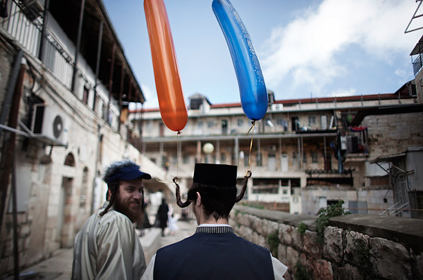 Pictures of the Week: Jewish orthodox men walk in the street of the conservative Mea Shearim neighborhood in Jerusalem during the commemoration