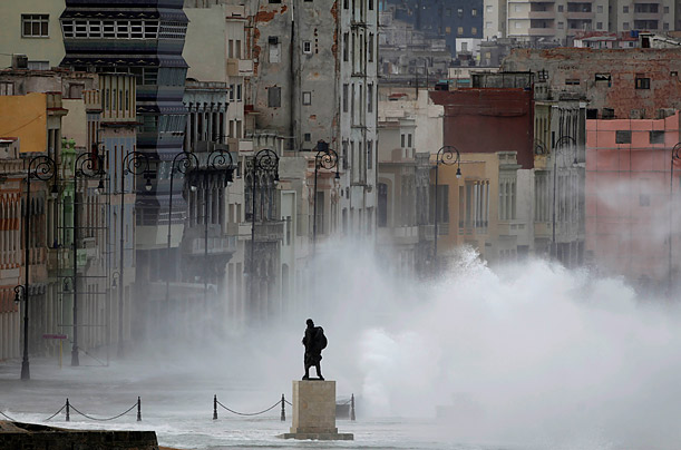 Pictures of the Week: The monument of Venezuelan independence hero Francisco de Miranda is seen as waves splash on Malecon avenue in Havana, Wednesday, March 3, 2010.