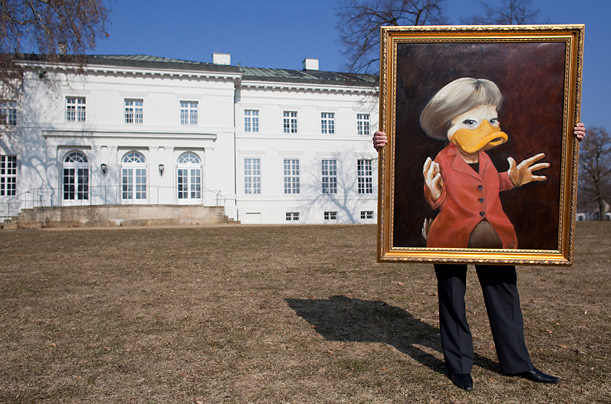 A member of the museum staff presents an alienated The by artist Ommo Wille from Jever in front of Castle Neuhardenberg, Germany, 10 Marc