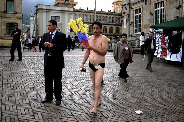 An anti-bullfighting activist in Bogota walks to the site of a demonstration on Thursday.
