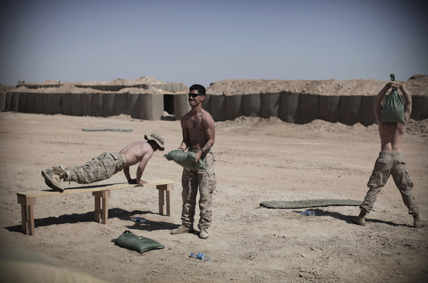 US Marines and an Afghani interpreter work out at an improvised gym inside their base in Marjah, southern Afghanistan.