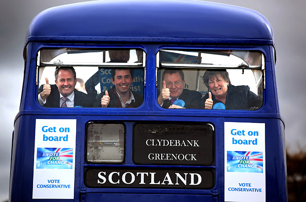 Scottish Conservative politicians hop on the party's campaign bus in Edinburgh.