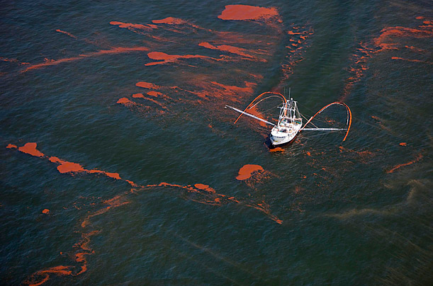 A shrimp boat takes part in a cleaning operation for the Deepwater Horizon oil spill off the coast of Louisiana.
