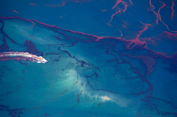 A ship maneuvers itself across the Gulf of Mexico as oil continues to leak from the Deepwater Horizon wellhead.
