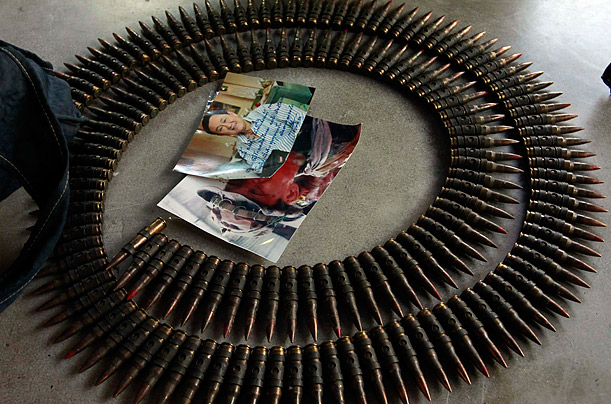 Remnants. Bullets and a picture of former Thai prime minister Thaksin Shinawatra are found in a Buddhist temple previously occupied by Thai