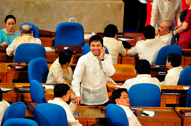 Boxer and politician Manny Pacquiao attends his first regular session of the Lower House of congress as a Filipino Congressman.